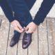 business man tying shoe